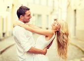 summer holidays, love, relationship and dating concept - smiling couple dancing in the city