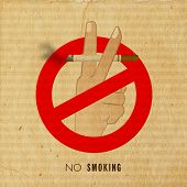 Vintage anti smoking poster, banner or flyer design with human hand holding a burning cigarette on g