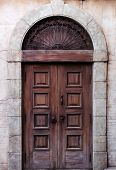 Old arched wooden door rustic vintage architectural detail texture