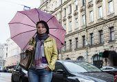 Woman walks in St. Petersburg, Russia.