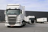 White Scania Trucks Ready To Unload At Warehouse Building
