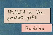 image of interpreter  - famous Buddha quote interpretation with sticker notes on vintage carton board - JPG