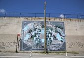 Iconic Antiquated Giant mural by artist Chris Soria at the India Street Mural Project in Brooklyn