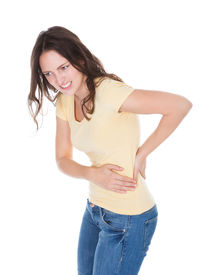 picture of sick kidney  - Portrait Of Young Woman Having Pain In Her Back Over White Background - JPG