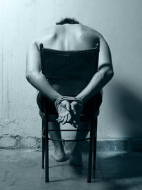 picture of torture  - Tortured man in a chair with cold tones - JPG