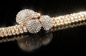 image of substitutes  - A shiny gold bracelet earrings and ring with cubic zirconia  - JPG
