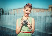 Beautiful Girl In Vintage Clothing With Retro Camera