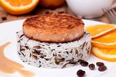 Salmon Medallion With Mixed Cooked Rice On White Plate