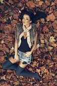 Young Women Lying In Fallen Leaves