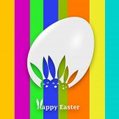 A graphic of a white Easter Egg with heads of bunnies on it on a multicolore background