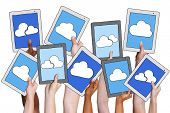 Arms Holding Digital Tablet with Cloud Computing Concept