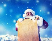 Santa Claus Holding Scroll Winter Concept
