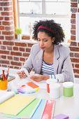 Interior designer looking at colours at her desk