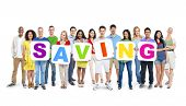 Multi-Ethnic Group Of People Holding Alphabet To Form Saving