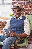 Smiling young man using digital tablet