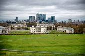 Cloudy Sky Over Grounds of National Maritime Museum with City Skyline in London, England