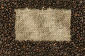 Cafe edition coffee beans on Jute backgroun
