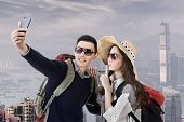 Asian couple travel and selfie in Hong Kong, Asia.