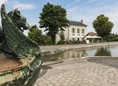 Statue And Restaurant At Canal And Loire