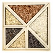 triangles and squares - rice grain abstract in an isolated wooden tray