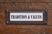 tradition and values  - - file cabinet label, bronze holder against grunge and scratched wood