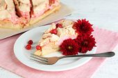 Piece of tasty pie with apples and berry mousse, on wooden background