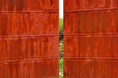 Rusty Corrugated Metal Red Wall And Gate
