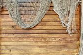 image of fishnet  - Hanging Fishnet on Wood Wall. Background and Texture for text or image.