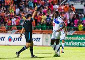 Sisaket Thailand-october 22: The Referee (black) Show The Yellow Card During Thai Premier League Bet