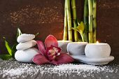 Spa set on bamboo mat on dark background