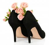 Beautiful woman shoes with flowers isolated on white