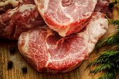 picture of lamb chops  - Close up Raw Fresh Meat Slices on Wooden Chopping Board - JPG