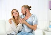 Young happy couple after therapy session with family psychologist
