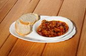 Cod in red pepper and tomato sauce.