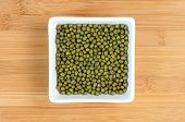 Green Mung Beans In White Bowl On Wooden Board