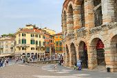 People In The Area Near Verona Arena In Preparation For The Annual Festival Of Opera.