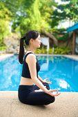 Asian Girl Meditating Yoga