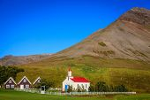 A small village in Iceland with church and turf houses