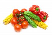 Tomatoes, Cucumbers, Corn And Sweet Peppers On A White Background