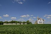 Granaries and a church in a bean field