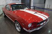 VALENCIA, SPAIN - OCTOBER 17, 2014: A red 1965 Ford Mustang Fast Back at the Retro Auto and Moto Valencia Classic Car Show. The first generation Mustang was produce between the years 1964 and 1973.