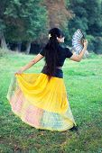 Woman Dancing With Traditional Fan