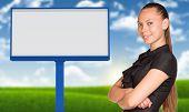 Businesswoman and big empty billboard