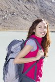 Young Female Hiker Outdoors With Her Backpack