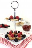 Poffertjes With Blackberries On A Cake Stand