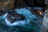 image of rough-water  - Golden rock shining into rough water - JPG