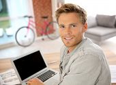 Student at home working on laptop