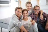 Group of young people sitting in shared apartment