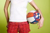 Teenage girl holding basketball