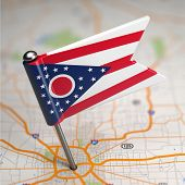 Ohio Small Flag on a Map Background.